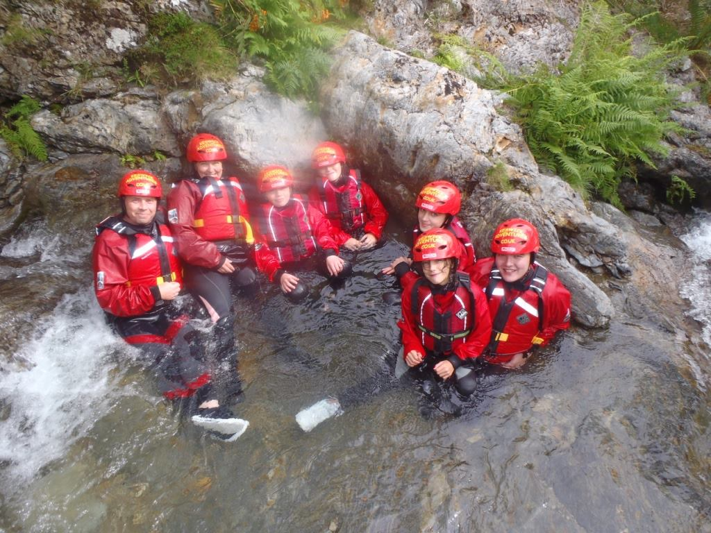 Family ghyll scrambling in the Lake District