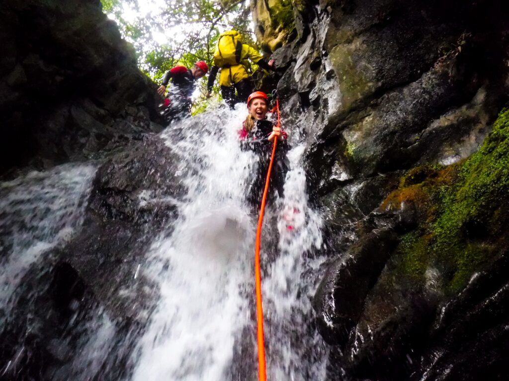 Teenager canyoning with Keswick Adventures
