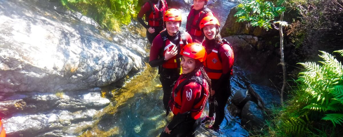 Teenagers canyoning in the Lake District
