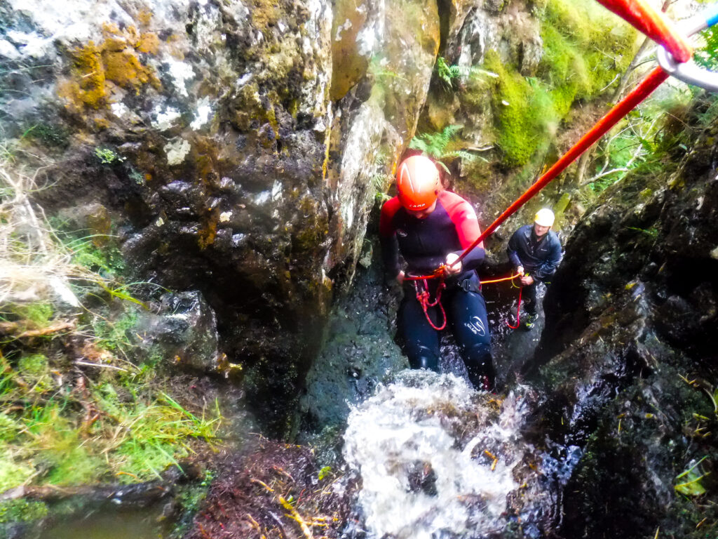 Abseiling while canyoning