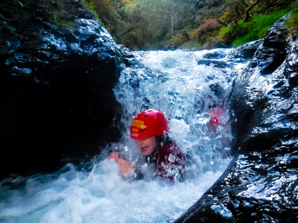 Person ghyll scrambling in the Lake District
