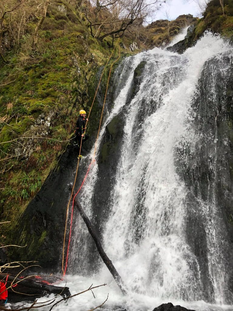 Lee Simpson abseiling down a waterfall