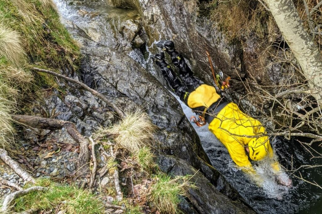 Person diving into the water at Stoneycroft Ghyll near Keswick