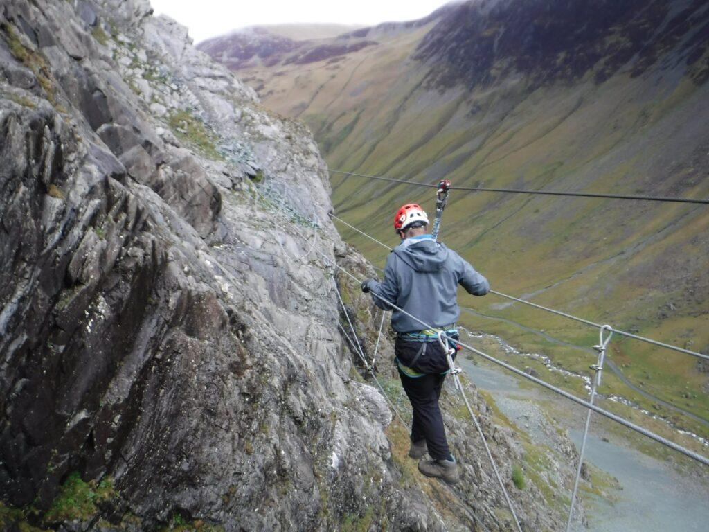 Man on rope bridge on the Via Ferrata at Honister Slate Mine
