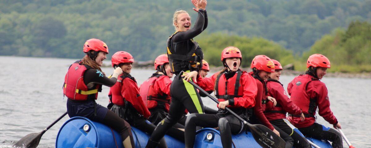Group sailing a raft on Derwentwater