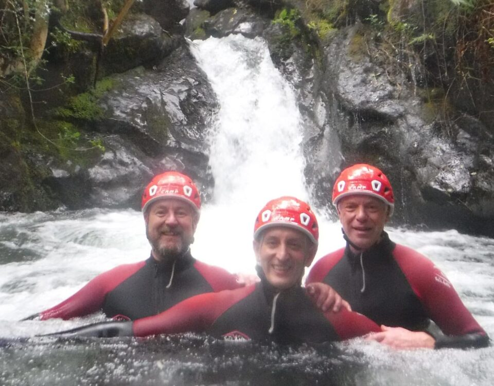 Group of three men ghyll scrambling in the Lake District