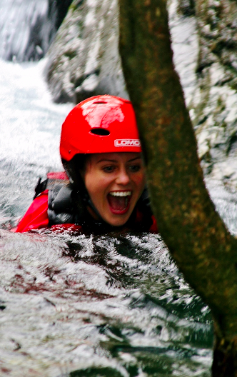 Happy woman ghyll scrambling in the Lake District