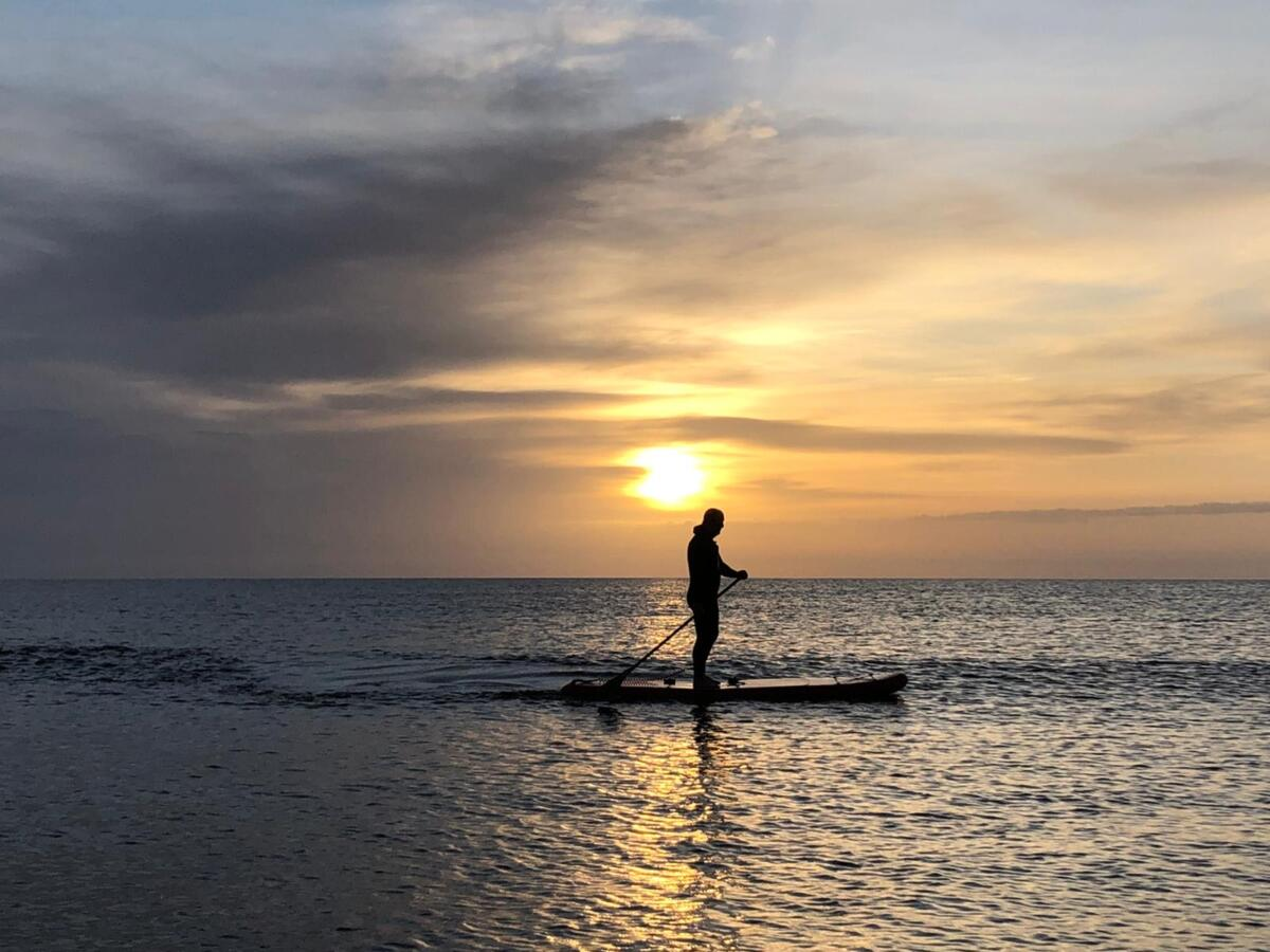 Paddle boarding at sunset with Keswick Adventure