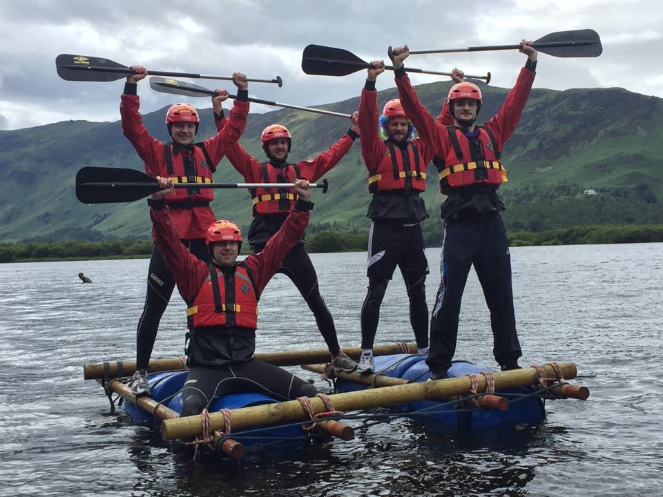Stag party celebrating building a raft in the Lake District